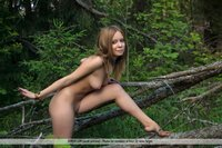Nude teen playing in the woods